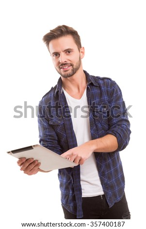 Handsome man relaxing with a tablet computer - stock photo