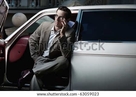 Handsome man sitting in the car - stock photo