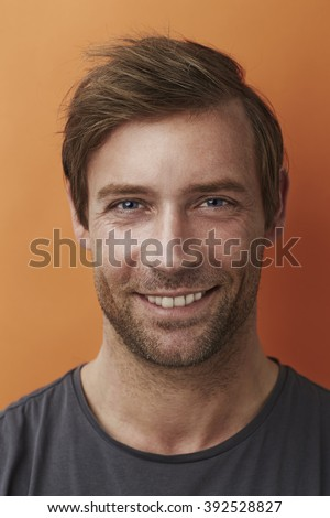 Handsome man smiling at camera - stock photo