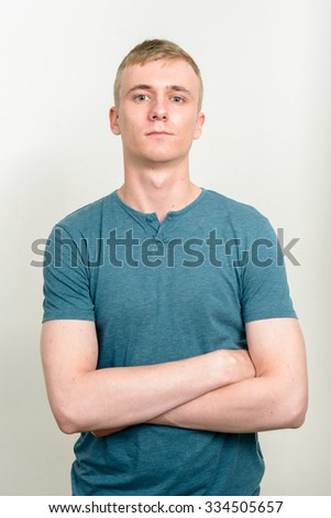 Handsome man standing - stock photo
