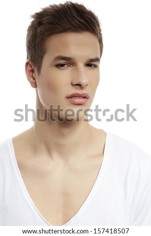 Handsome man standing with white t-shirt close up portrait on white background. - stock photo