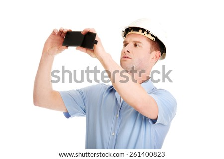 Handsome man taking photos by his mobile phone. - stock photo