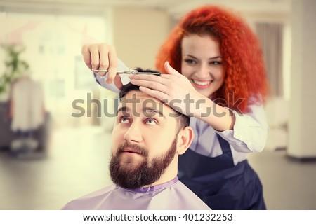 Handsome man visit barber shop - stock photo