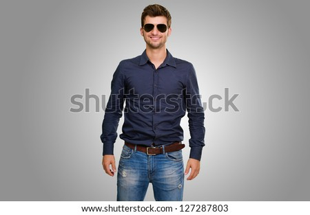Handsome man wearing shirt against a grey background - stock photo