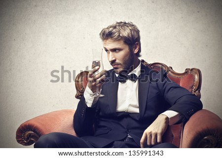handsome man with a glass of champagne - stock photo