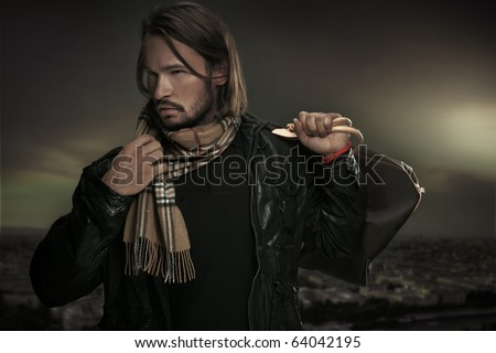 Handsome man with bag - stock photo