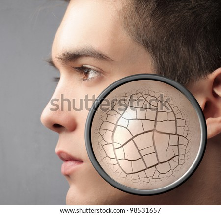 Handsome man with closeup of his wrinkled skin - stock photo