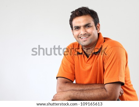 Handsome man with crossed arms - stock photo