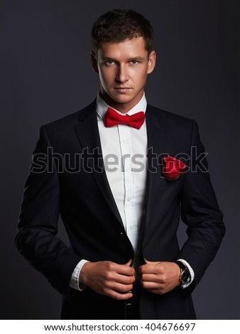 Handsome man with flower. young groom man in suit.elegant boy - stock photo