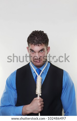 handsome man with hangman noose around his neck - stock photo