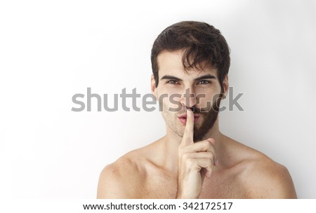 Handsome man without a shirt standing in front of a camera with half of his face with scruffy beard and messy hair, the other half has a beautiful trimmed beards and smart look hair style. - stock photo