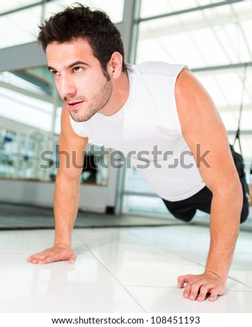 Handsome man working out at a sports center - stock photo
