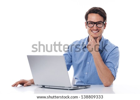 Handsome man working with laptop - stock photo