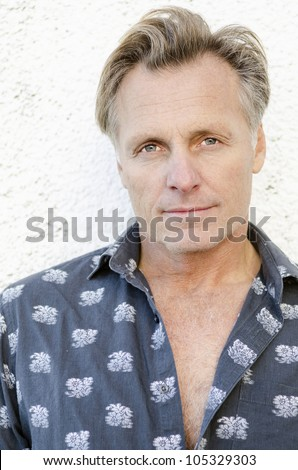 handsome mature blond man in his forties - stock photo