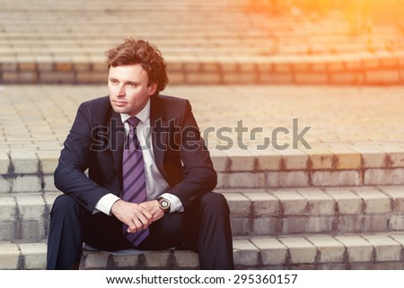 Handsome mature caucasian businessman outdoor wearing suit - stock photo