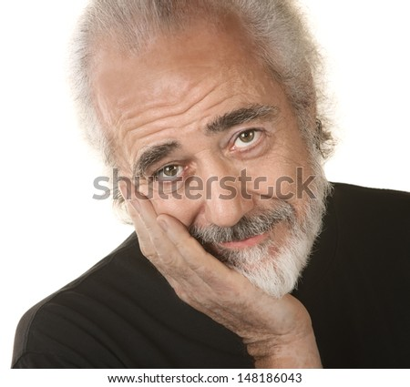 Handsome mature man resting head in palm - stock photo
