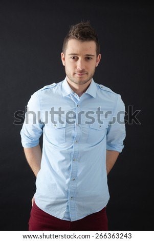 Handsome men doing different expressions in different sets of clothes: posing - stock photo