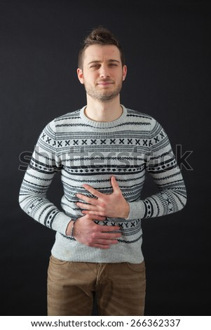 Handsome men doing different expressions in different sets of clothes: stomachache - stock photo