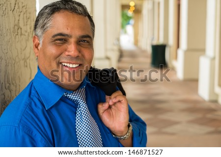 Handsome middle age Hispanic man in an urban setting. - stock photo
