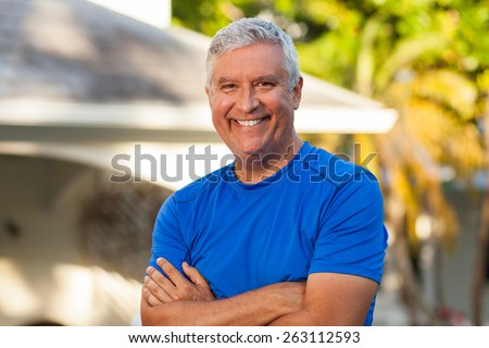 Handsome middle age man outdoor portrait in a home setting. - stock photo