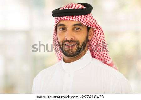 handsome middle eastern man looking at the camera - stock photo