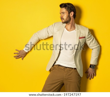 Handsome model on yellow background - stock photo