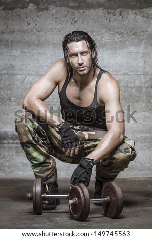 handsome muscle man wearing camouflage pants - stock photo