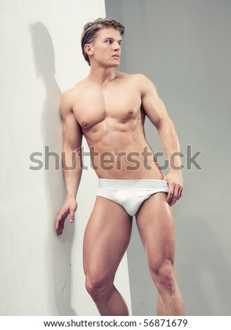 Handsome muscular guy - stock photo