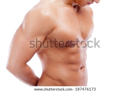 Handsome muscular guy on white background - stock photo