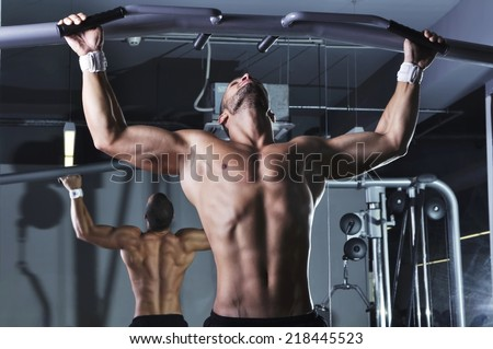 Handsome Muscular Male Model With Perfect Body Doing Pull Ups - stock photo