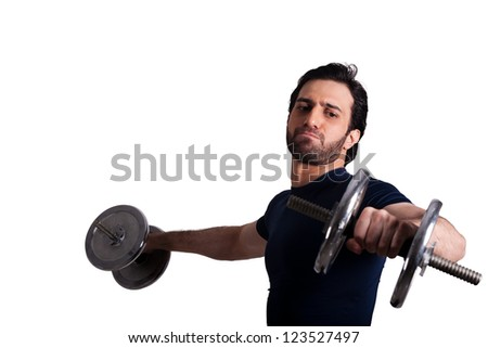 handsome muscular man exercising with dumbbells - stock photo