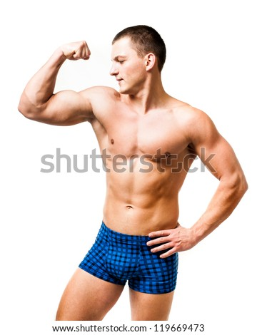 Handsome muscular man isolated on a white background - stock photo