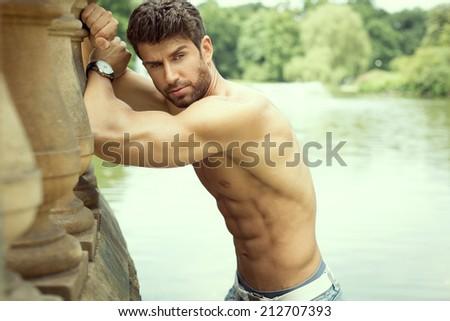 Handsome muscular man posing  - stock photo