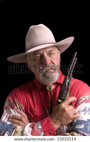 Handsome old baby-boomer Cowboy dressed in black and looking like Buffalo Bill Cody - stock photo