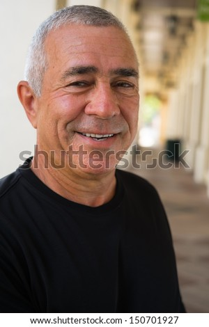 Handsome older man outdoor portrait. - stock photo