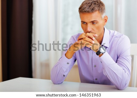 Handsome pensive man - stock photo