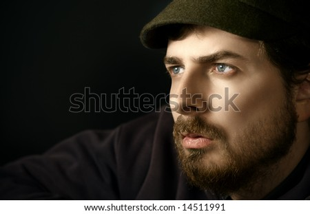 Handsome pensive man with beautiful blue eyes - stock photo