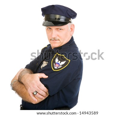 Handsome policeman leaning back on invisible white space, with a sexy expression.  Isolated design element. - stock photo