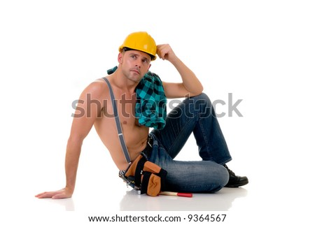 Handsome pre middle aged construction worker in sensual pose, white background,  studio shot. - stock photo