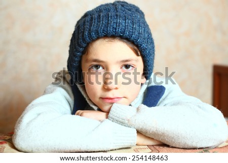 handsome preteen boy expressive portrait in winter knitted hat - stock photo