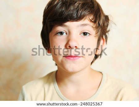 handsome preteen boy serious close up portrait - stock photo