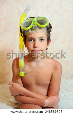 handsome preteen boy with snorkeling mask and tube - stock photo