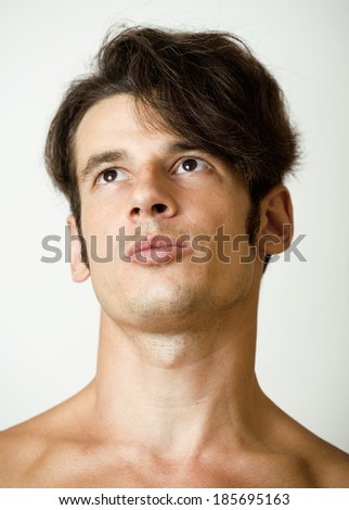 handsome real man thinking, isolated - stock photo