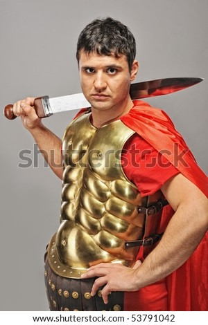 Handsome roman legionary soldier - stock photo