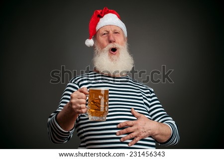 Handsome sailor isolated on black background. Seaman. Santa claus with beer - stock photo