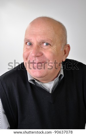 handsome senior man making funny faces - stock photo