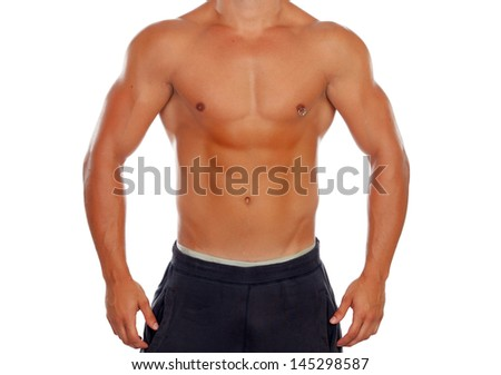 Handsome shirtless young man with defined muscles and a piercing isolated on a white background - stock photo