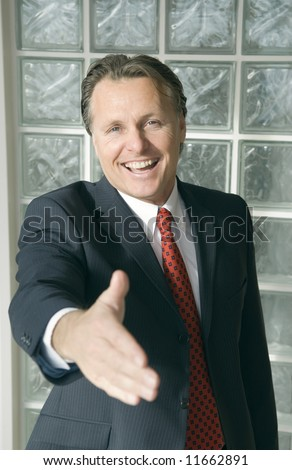 Handsome smiling businesman - stock photo