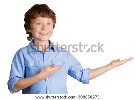 Handsome smiling caucasian boy with red hair points with his hands. Isolated on white background - stock photo