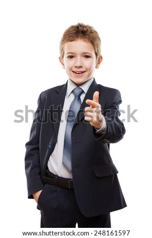 Handsome smiling child boy in business suit index finger pointing direction way or campaign agitating choice white isolated - stock photo